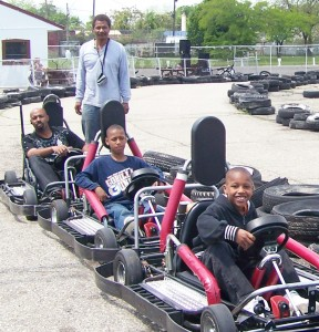 Doll's Go Kart Track owner Ron Hereford, with young customers.